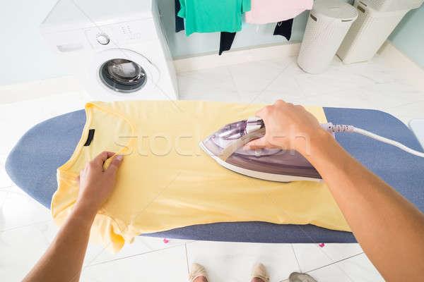 Woman Hand Ironing T-shirt On Ironing Board Stock photo © AndreyPopov