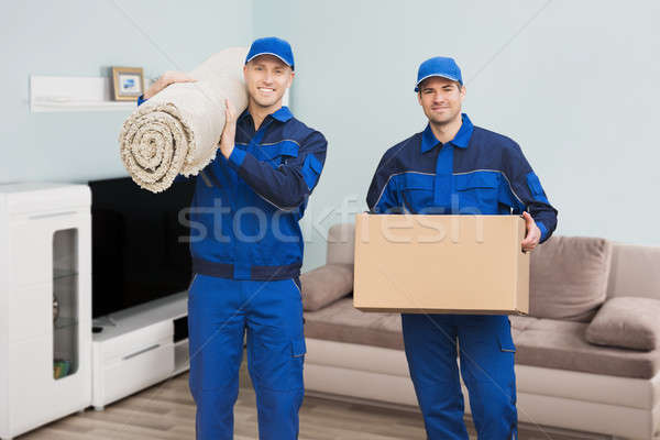 Two Male Movers Standing In House Stock photo © AndreyPopov