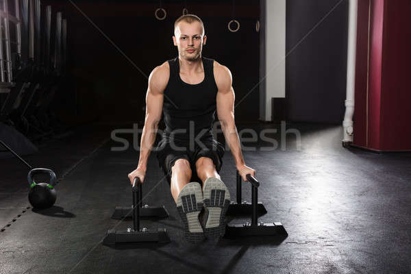 Portrait Of A Man Doing Push-up Exercise Stock photo © AndreyPopov