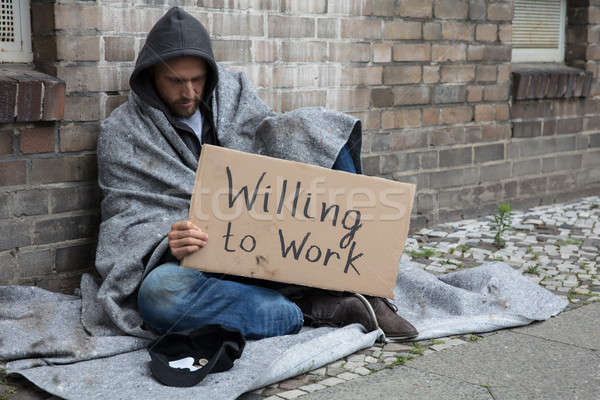Homeless Man Holding Cardboard With Text Willing To Work Stock photo © AndreyPopov