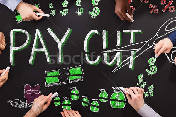Salario pizarra manos dibujo grupo financiar Foto stock © AndreyPopov