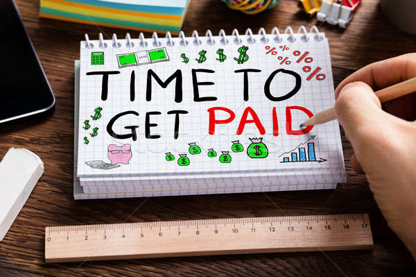 Time To Get Paid In Notepad Stock photo © AndreyPopov