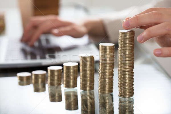 Businessperson Hand Put Coins To Stack Of Coins Stock photo © AndreyPopov