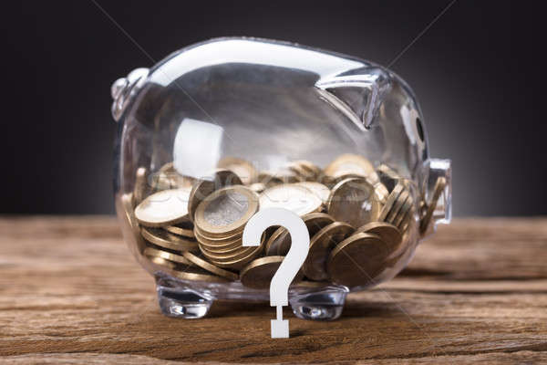 Question Mark And Coins In Transparent Piggy Bank Stock photo © AndreyPopov