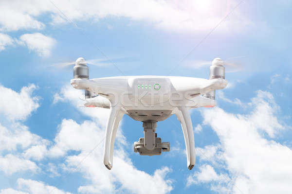 Drone flying against cloudy sky Stock photo © AndreyPopov