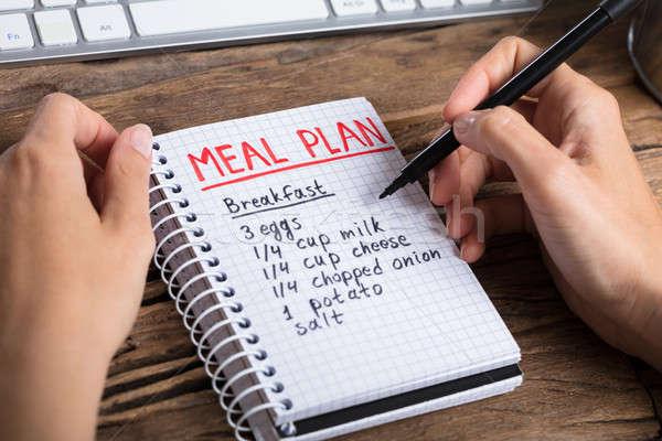 Mão humana refeição plano caderno Foto stock © AndreyPopov