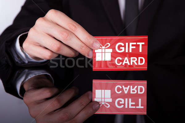Businessman Hand Giving Red Gift Card Stock photo © AndreyPopov