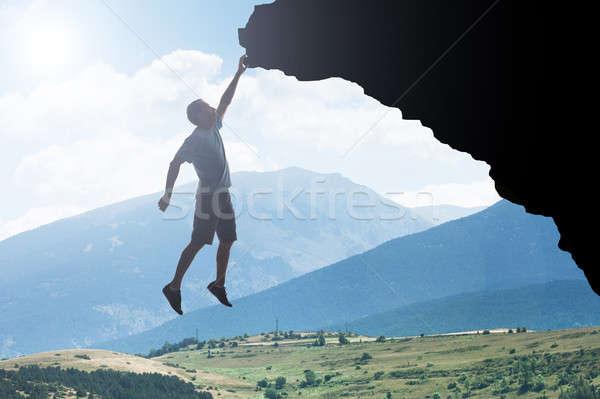 Uomo net impiccagione rock mano panorama Foto d'archivio © AndreyPopov