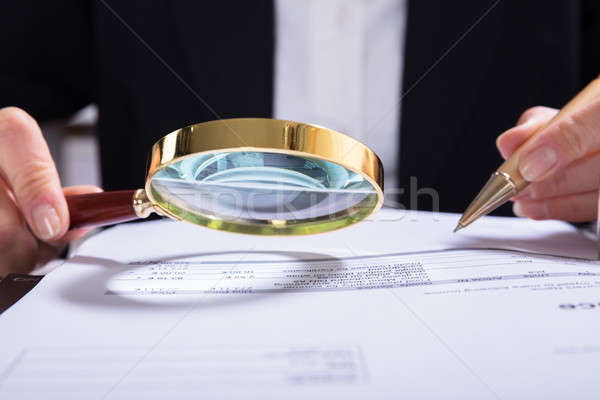 Auditor Inspecting Financial Documents At Desk Stock photo © AndreyPopov