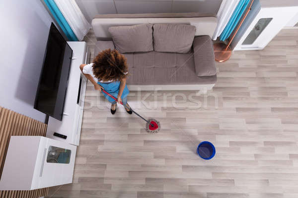 Female Janitor Cleaning Floor With Mop Stock photo © AndreyPopov