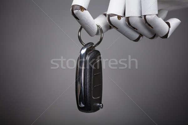 Robot Holding Car Key Stock photo © AndreyPopov