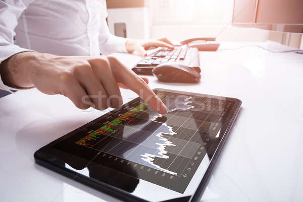 Stock photo: Close-up Of A Businessperson Using Digital Tablet