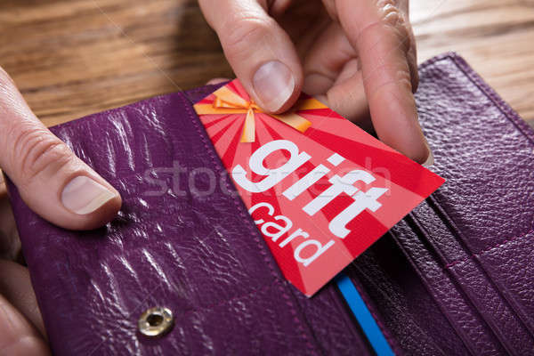 Human Hand Removing Gift Card From Purse Stock photo © AndreyPopov