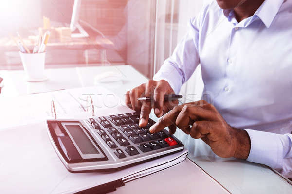 Biznesmen rachunek Kalkulator pracy działalności Zdjęcia stock © AndreyPopov