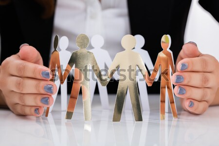Businessperson placing human figure on red chair Stock photo © AndreyPopov