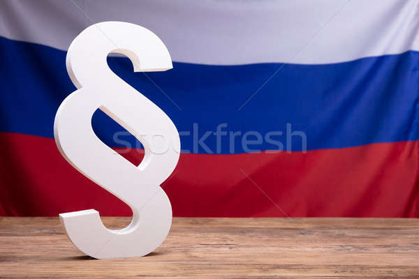 Close-up Of White Paragraph Symbol On Wooden Desk Stock photo © AndreyPopov