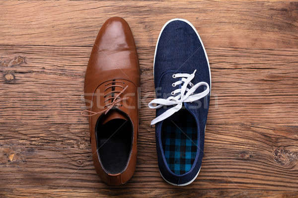Elevated View Of Two Different Shoe Stock photo © AndreyPopov