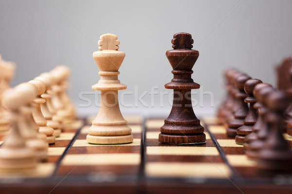 Wooden Chess Pieces On Board Game Stock photo © AndreyPopov