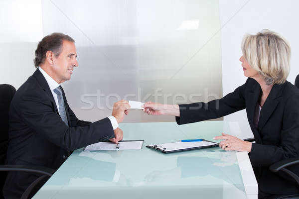 Businesspeople Exchanging Visiting Card In Office Stock photo © AndreyPopov