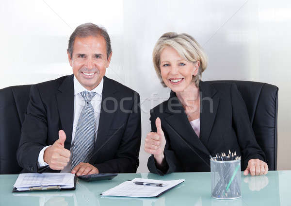 Businesspeople Showing Thump Up Sign Stock photo © AndreyPopov