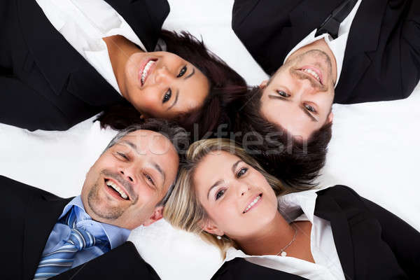Business people lying head to head Stock photo © AndreyPopov
