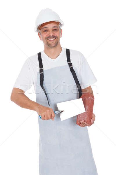Portrait of smiling bricklayer Stock photo © AndreyPopov
