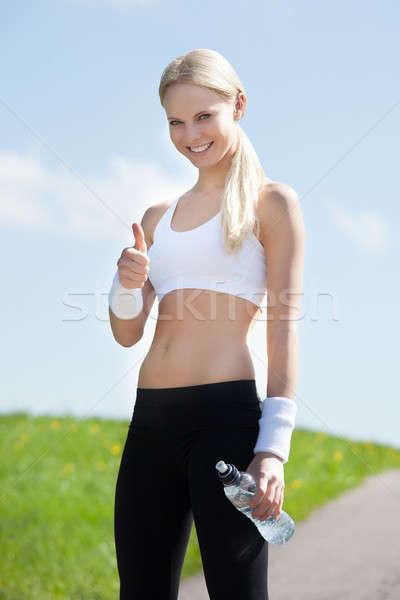Homme jogger une bouteille d'eau portrait heureux Photo stock © AndreyPopov