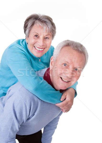 Couple de personnes âgées ferroutage portrait isolé blanche Photo stock © AndreyPopov