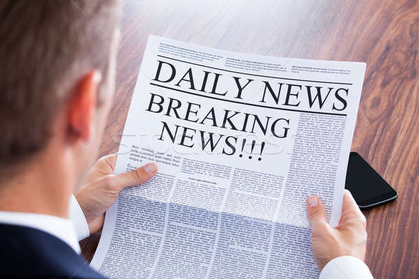 Stock photo: Young Businessman Reading Breaking News