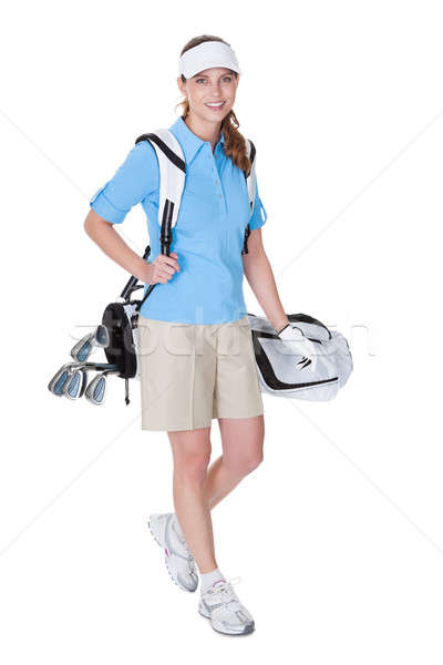 Stock photo: Golfer with a bag of clubs