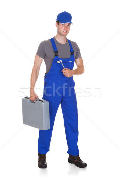 Mechanic Holding Ratchet Stock photo © AndreyPopov
