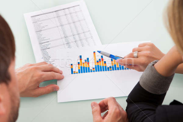 Partners discussing a business graph Stock photo © AndreyPopov