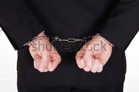 Gearresteerd man handboeien handen afrikaanse geïsoleerd Stockfoto © AndreyPopov