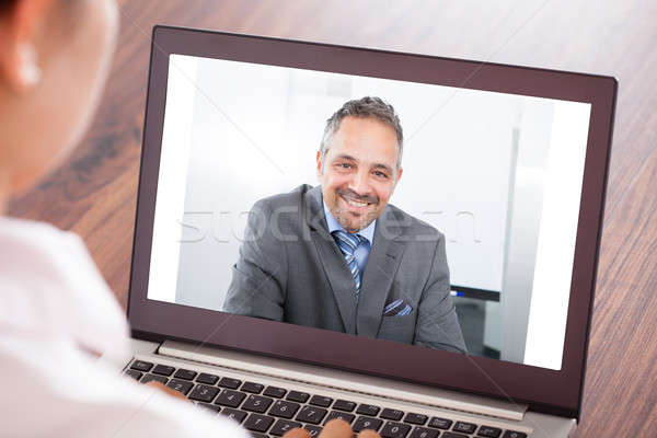 Woman Attending Video Conference Stock photo © AndreyPopov