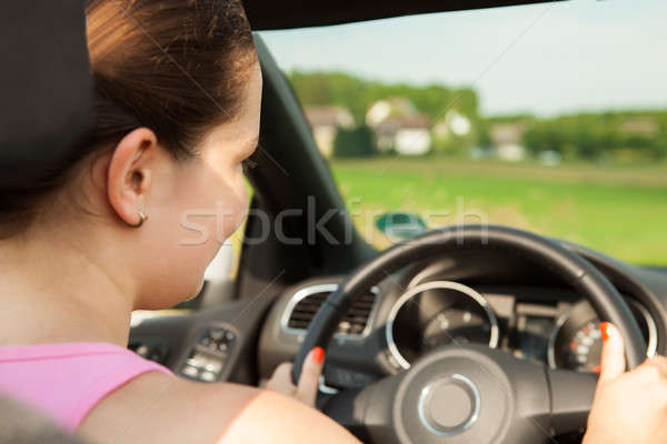 Happy Young Woman Driving The Car Stock photo © AndreyPopov