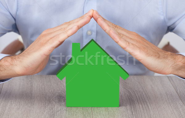 Businessman's Hands Over Green Model House Stock photo © AndreyPopov