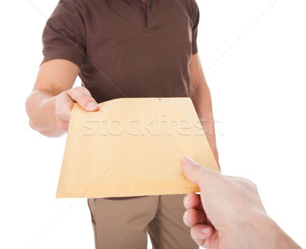 Primo piano postino mail persona bianco mano Foto d'archivio © AndreyPopov