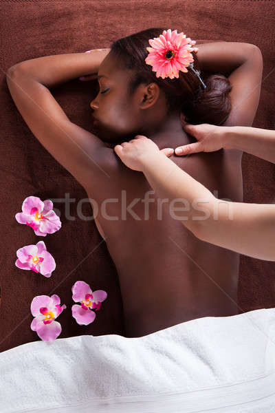 Stock photo: Woman Receiving Shoulder Massage At Spa