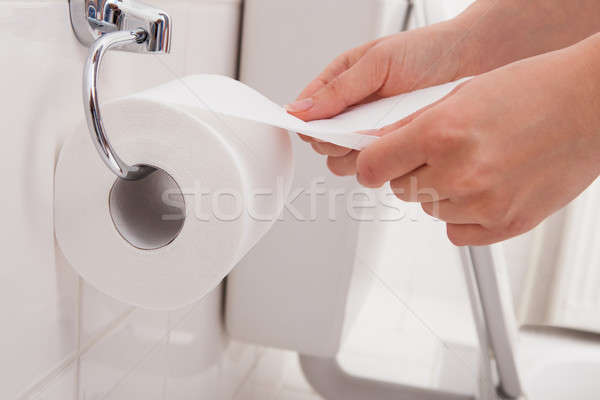 Person's Hand Using Toilet Paper Stock photo © AndreyPopov