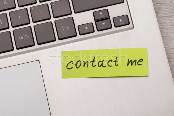 Contact Me Sticky Note On Laptop Stock photo © AndreyPopov