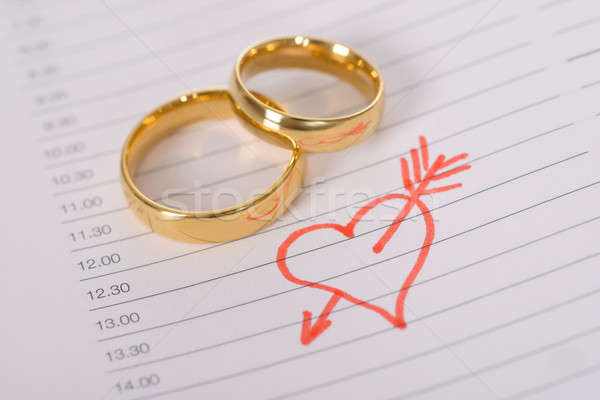 Close-up Of Wedding Rings On Paper Stock photo © AndreyPopov