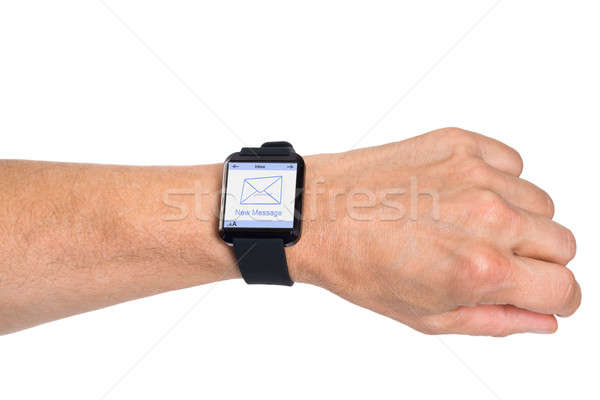 Hand Wearing Smartwatch Showing New Message Stock photo © AndreyPopov