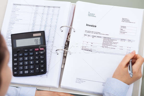 Businessperson With Document And Calculator Stock photo © AndreyPopov
