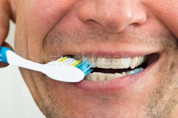 Man Brushing Teeth Stock photo © AndreyPopov