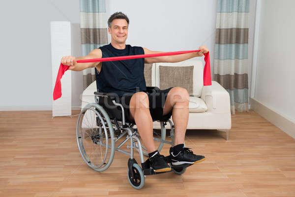 Gehandicapten man rolstoel weerstand band Stockfoto © AndreyPopov