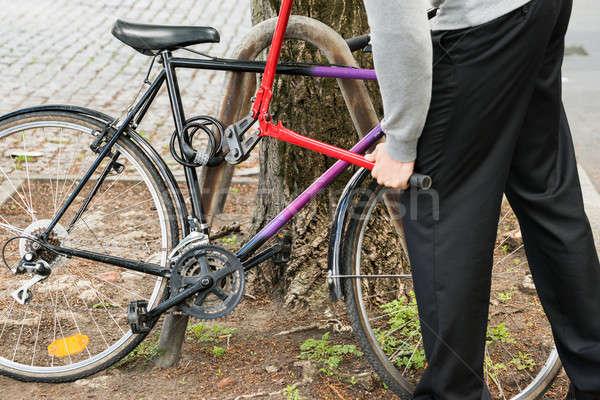 Thief Breaking The Bicycle Lock Stock photo © AndreyPopov