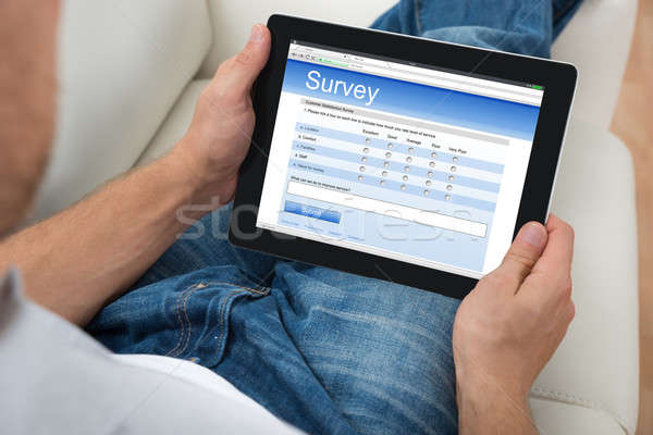 Person With Digital Tablet Showing Survey Form Stock photo © AndreyPopov