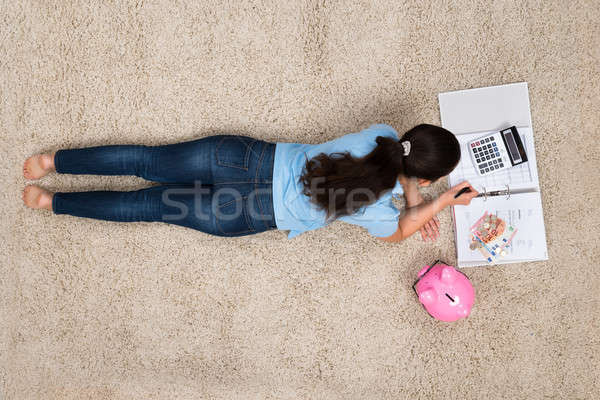Woman Doing Calculation At Home Stock photo © AndreyPopov