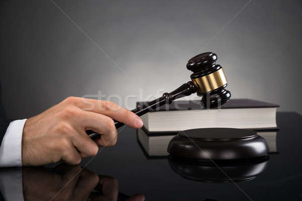 Close-up Of Judge Hitting Gavel Stock photo © AndreyPopov