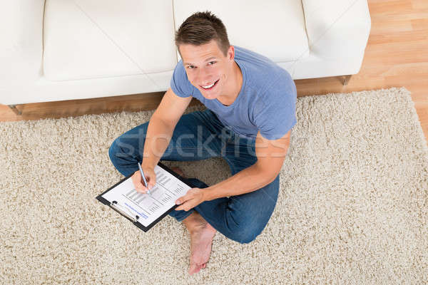 Man Filling Survey Form Stock photo © AndreyPopov